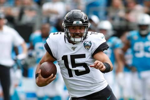 Jacksonville Jaguars quarterback Gardner Minshew (15) runs against the Carolina Panthers during ...