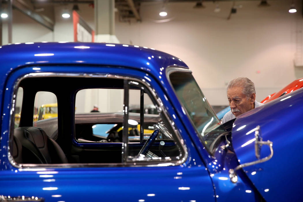 Bob Gutierrez of Las Vegas checks out a 1952 Chevrolet 3100 5-Window pickup that will be in the ...