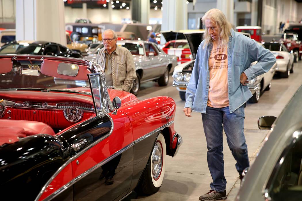 Lon Carlson, left, and Roger Olsen of Las Vegas check out cars during Mecum Las Vegas auction a ...