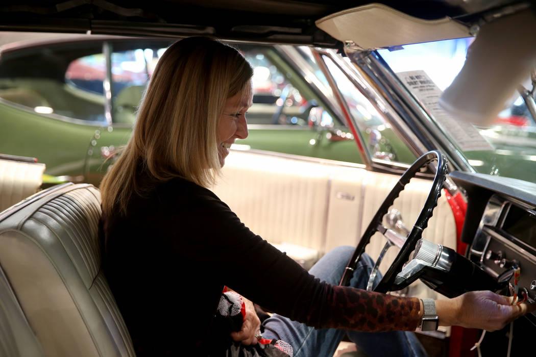 Donna Cantrell of Bakersfield, Calif. checks out a 1965 Pontiac Parisienne Custom Sport convert ...