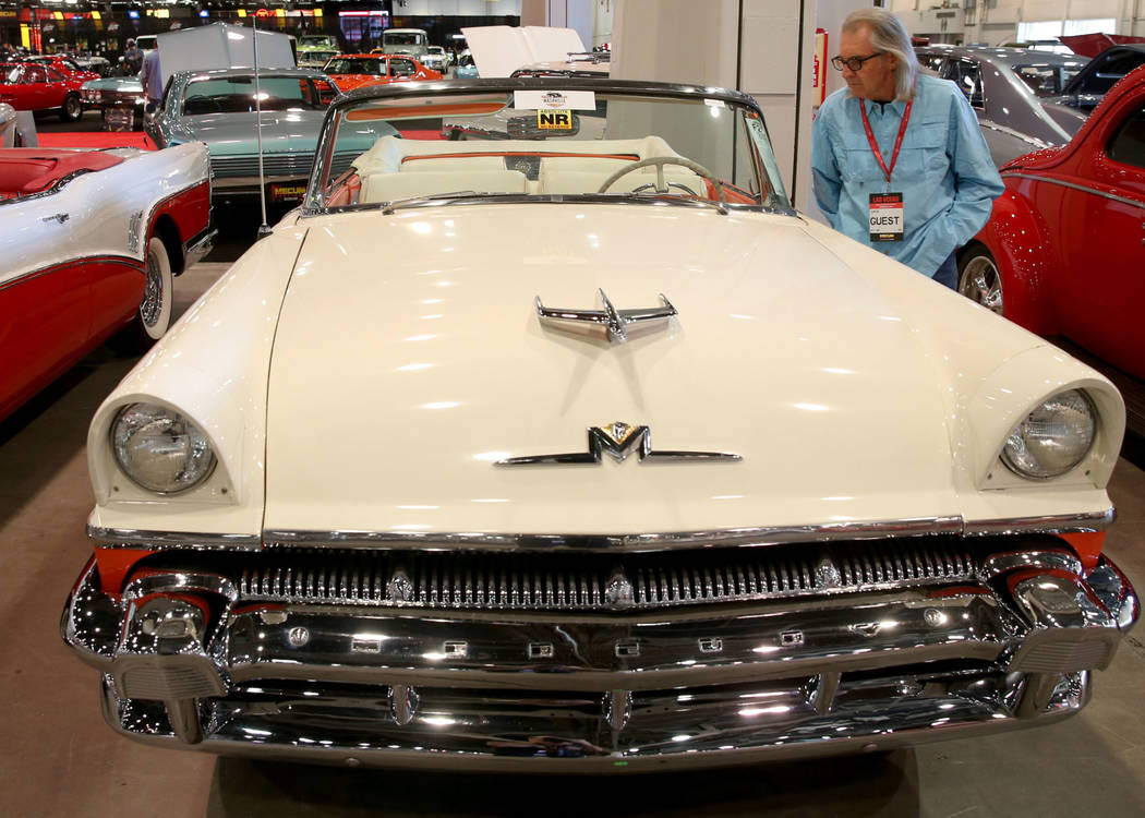 Earl Brady of Las Vegas checks out a 1956 Mercury Montclair convertible that will be in the Fri ...