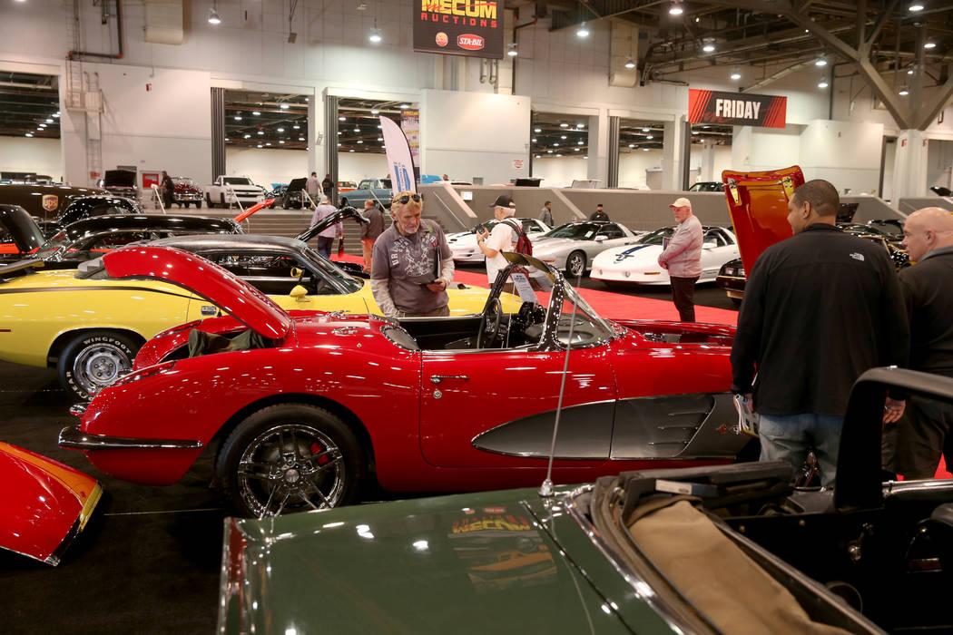 People check out cars during Mecum Las Vegas auction at the Las Vegas Convention Center Thursda ...