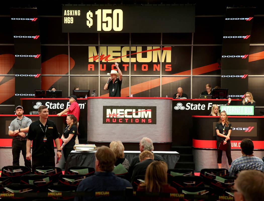 Auctioneer Matt Moravec of David City, Neb. calls during Mecum Las Vegas auction at the Las Veg ...