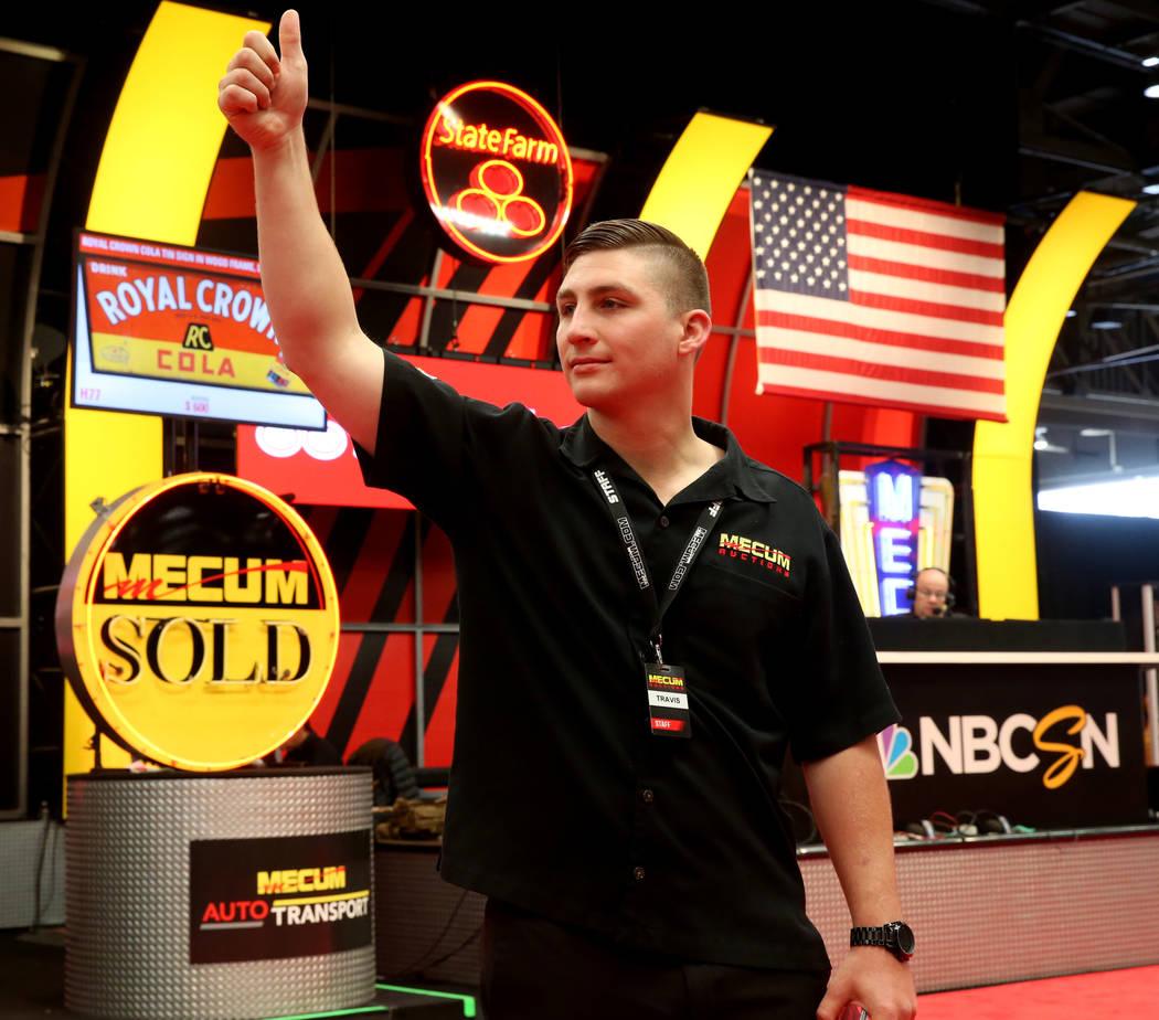 Ringman Travis Delzell signals during Mecum Las Vegas auction at the Las Vegas Convention Cente ...