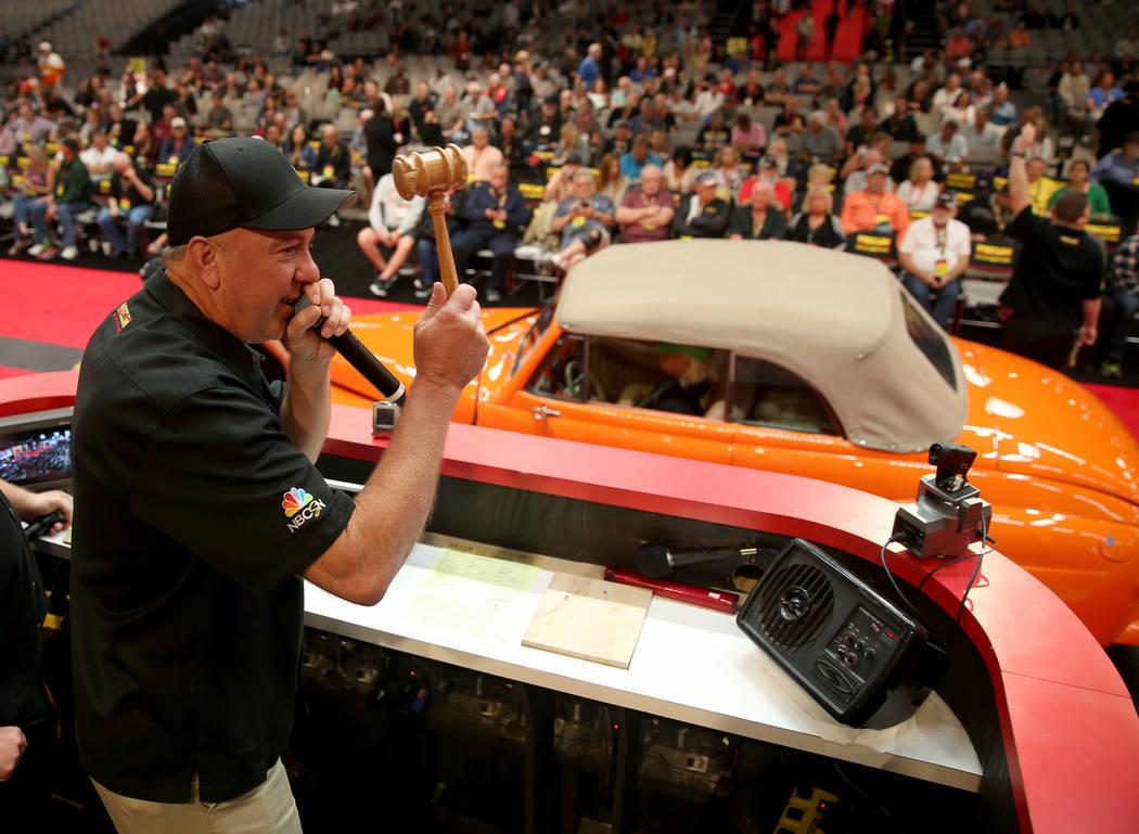 Auctioneer Russ Conklin of Hallsville, Mo. calls during Mecum Las Vegas auction at the Las Vega ...