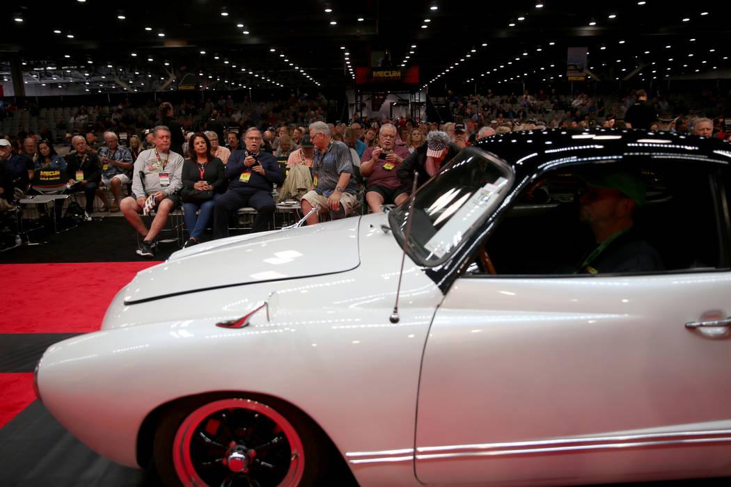 Bidders check out a 1972 Volkswagen Karmann Ghia on the auction block during Mecum Las Vegas au ...