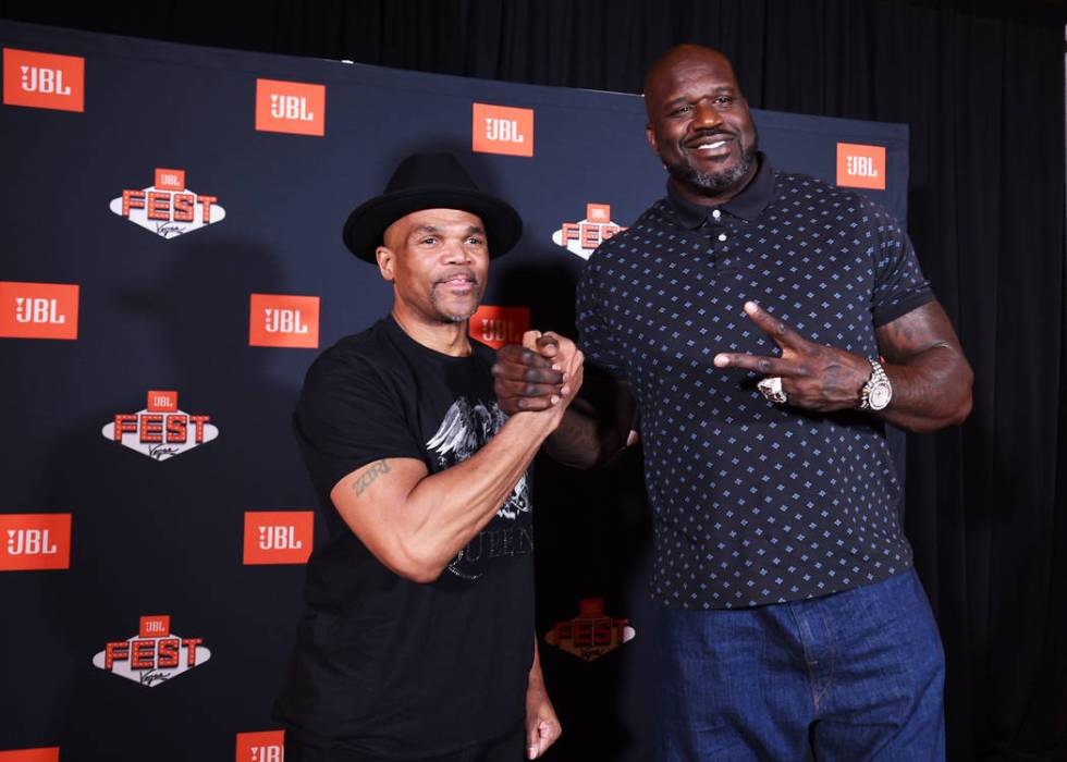 Darryl McDaniels of Run-D.M.C., left, mingles with Shaquille O'Neal during a meet and greet at ...
