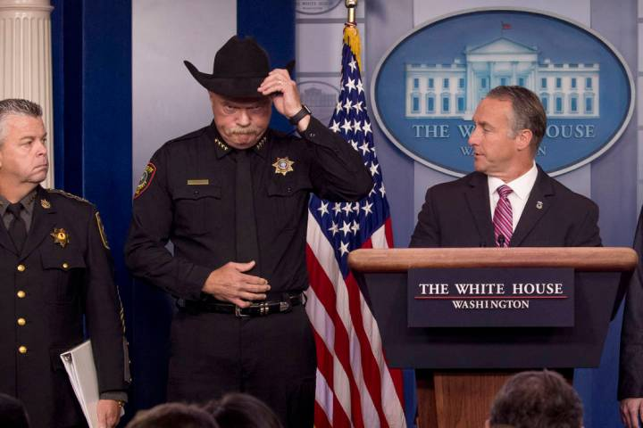 Immigration and Customs Enforcement Director Matt Albence, right, accompanied by sheriffs from ...