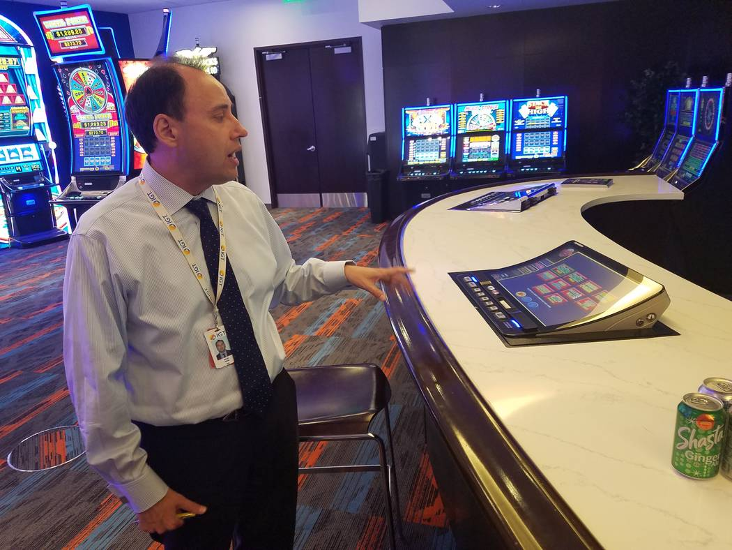 Nick Khin, chief commercial officer of gaming for IGT, shows off IGT's new curved-screen bartop ...