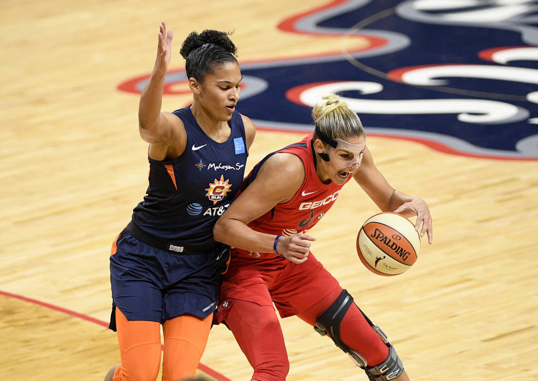 Washington Mystics forward Elena Delle Donne, right, dribbles the ball next to Connecticut Sun ...
