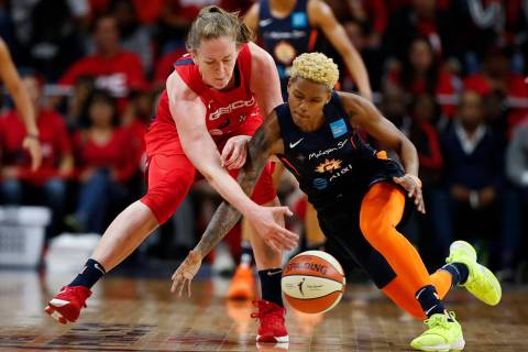 Washington Mystics center Emma Meesseman, left, and Connecticut Sun guard Courtney Williams go ...