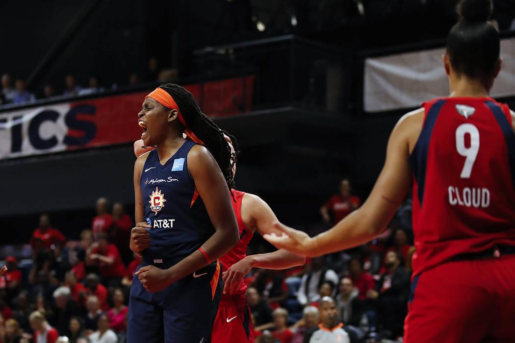 Connecticut Sun forward Jonquel Jones, left, celebrates after her basket during the first half ...
