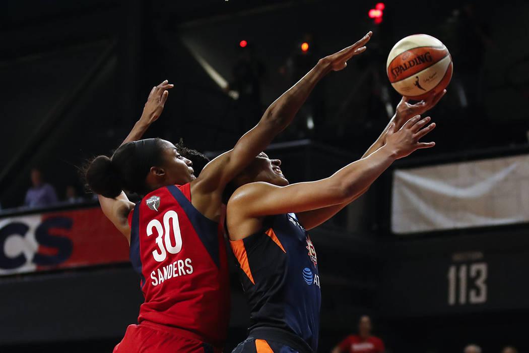 Connecticut Sun forward Alyssa Thomas, right, shoots past Washington Mystics forward LaToya San ...