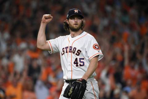 Houston Astros starting pitcher Gerrit Cole (45) reacts after an out against the Tampa Bay Rays ...