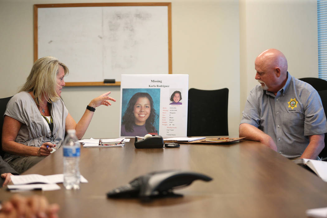 Homicide cold case investigator Terri Miller, left, and Las Vegas police homicide cold case inv ...