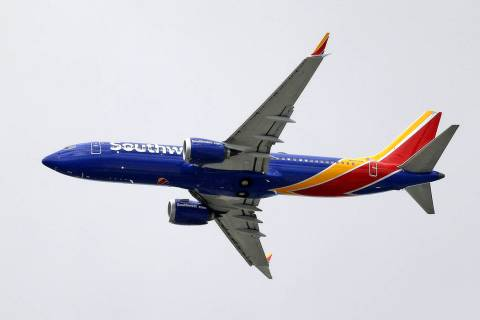 In a Wednesday, March 13, 2019, file photo, a Southwest Airlines Boeing 737 Max 8 jet flies ove ...