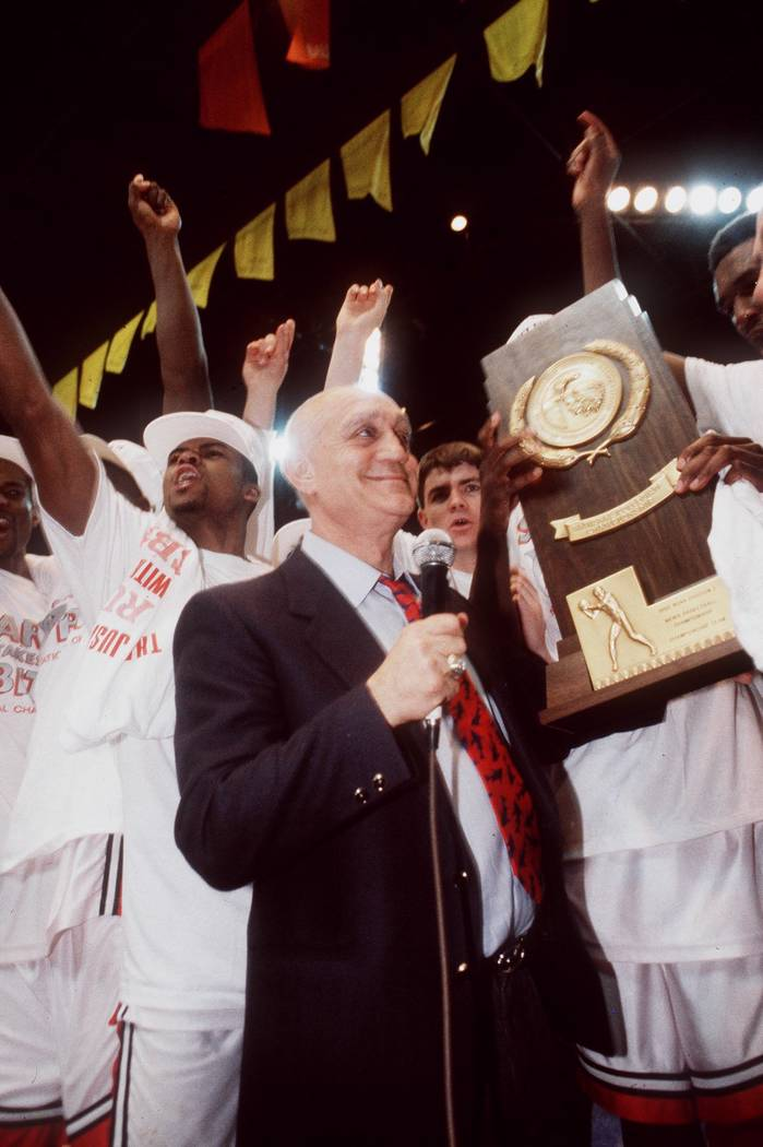 UNLV head basketball coach Jerry Tarkanian stands with his team after the Runnin' Rebels won th ...