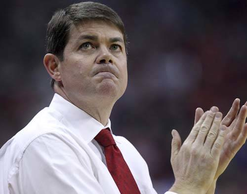 UNLV head coach Dave Rice claps after instructing his team during the first half of an NCAA bas ...
