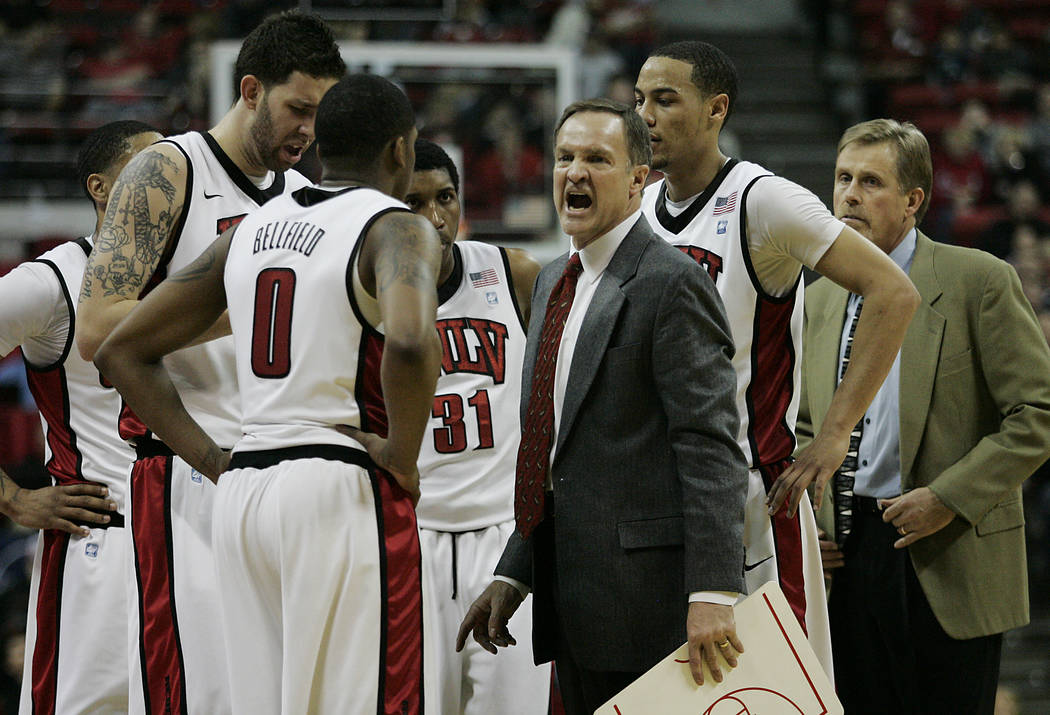 UNLV head coach Lon Kruger tries to motivate his team during a timeout against the Air Force Ac ...