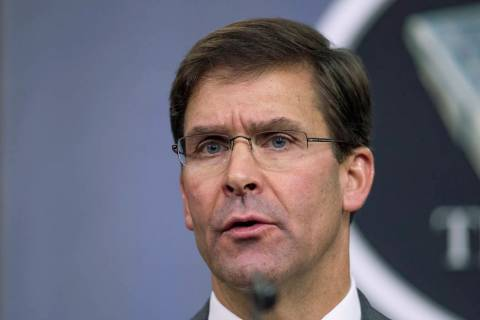 In an Aug. 28, 2019, file photo, Secretary of Defense Mark Esper speaks to reporters during a b ...