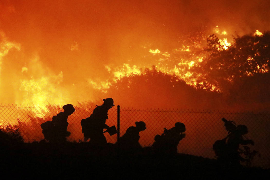 Firefighters battle the Saddleridge fire in Sylmar, Calif., Friday Oct. 11, 2019. (AP Photo/Dav ...