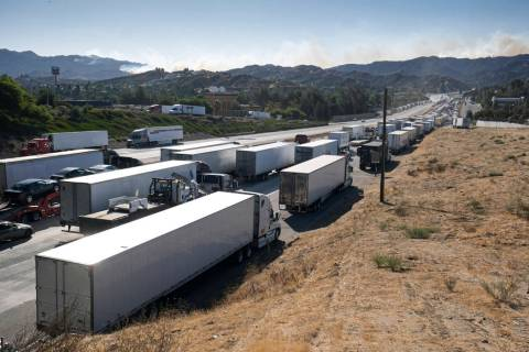 Miles of trucks wait along the I-5 freeway in Newhall, Calif., as the major roadway leading int ...