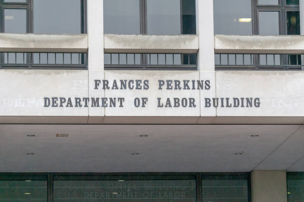A photo of the sign on the front entrance of the Department of Labor building in Washington, D. ...