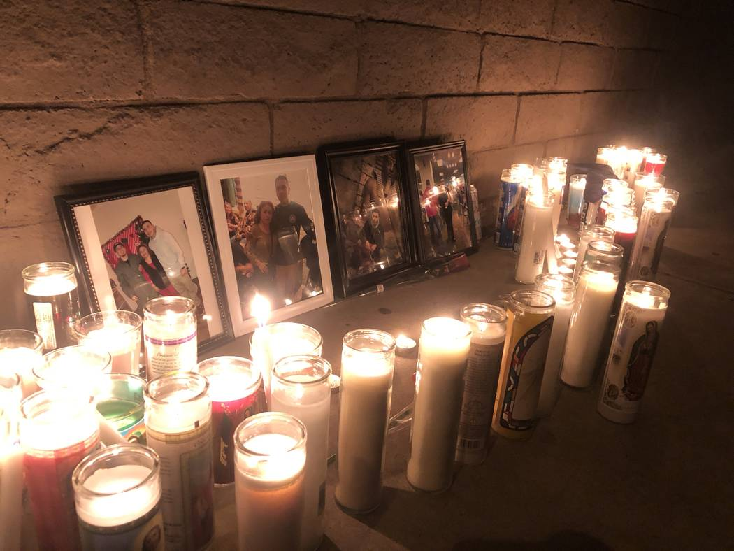 Pictures of 24-year-old Marco Antonio Alvizo are surrounded by religious candles on Friday, Oct ...