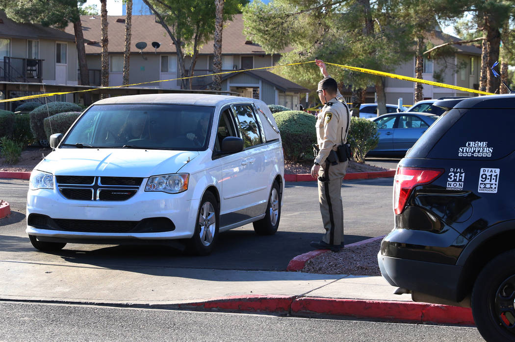 A van carrying the body of a shooting victim leaves the crime scene as Las Vegas police investi ...