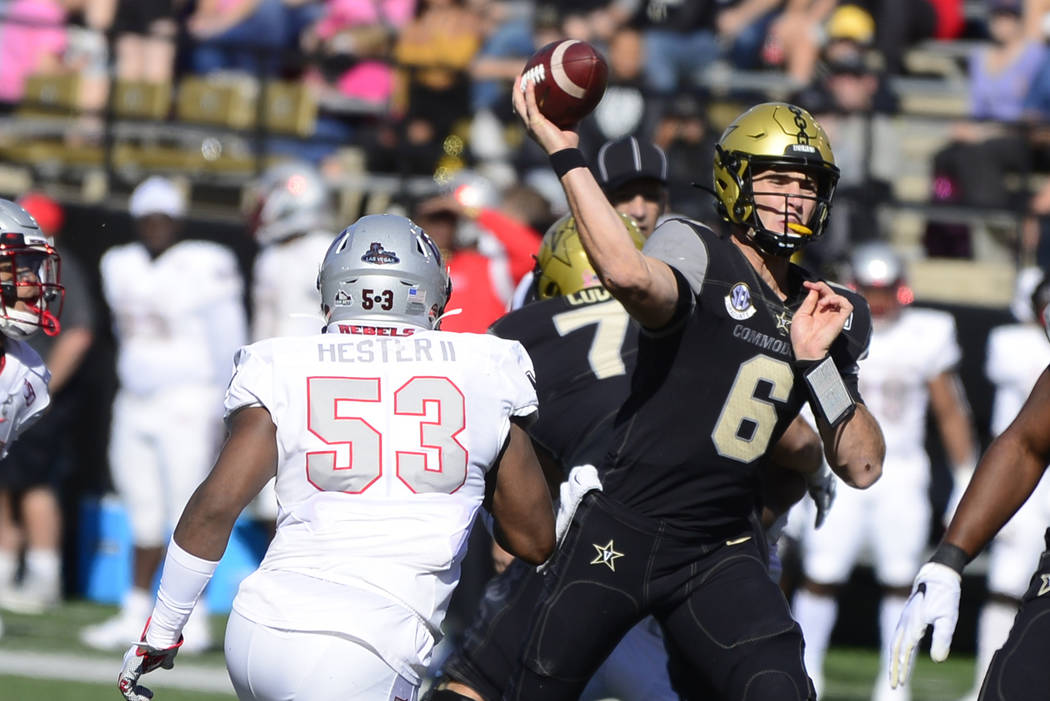 Vanderbilt quarterback Riley Neal (6) throws downfield against UNLV in the first half of an NCA ...