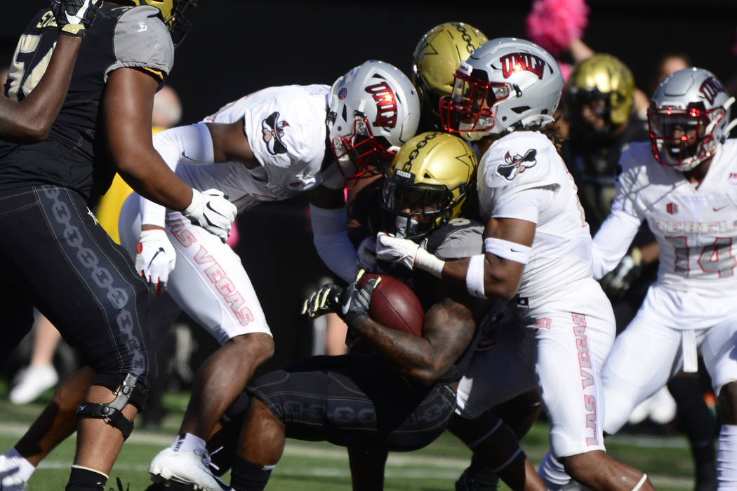 Vanderbilt running back Ke'Shawn Vaughn scores a touchdown against UNLV in the first half of an ...