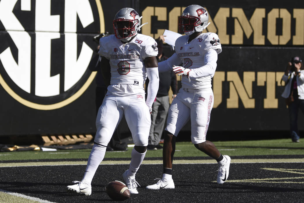 UNLV running back Charles Williams (8) celebrates a touchdown against Vanderbilt along with rec ...