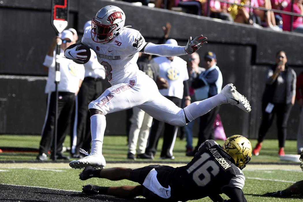 UNLV running back Charles Williams (8) scores a touchdown past Vanderbilt cornerback BJ Anderso ...