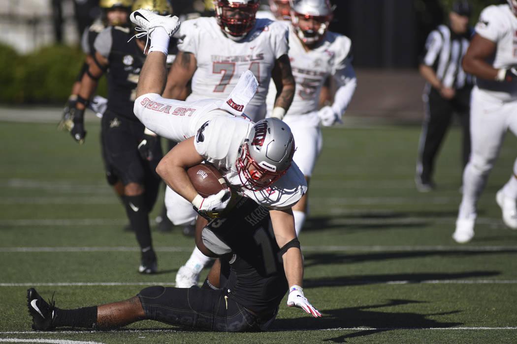 UNLV running back Chad Maygar, top, is tackled by Vanderbilt defender Brendon Harris, bottom, i ...