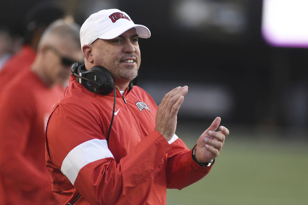 UNLV Head Coach Tony Sanchez encourages his team against Vanderbilt in the second half of an NC ...