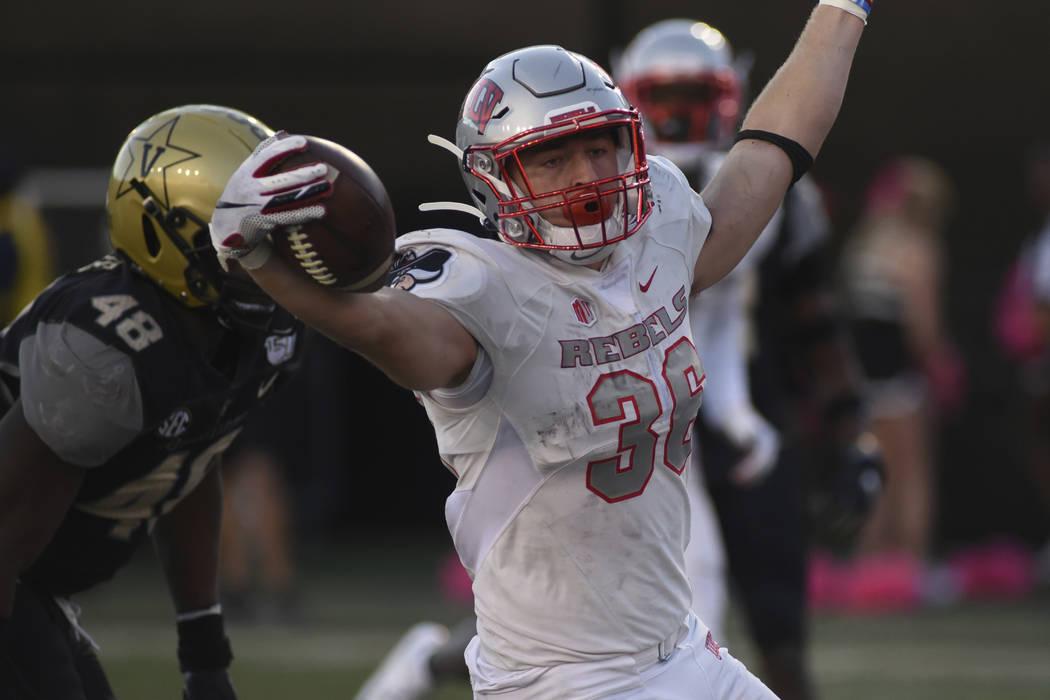 UNLV running back Chad Maygar, right, celebrates a touchdown past Vanderbilt linebacker Andre M ...