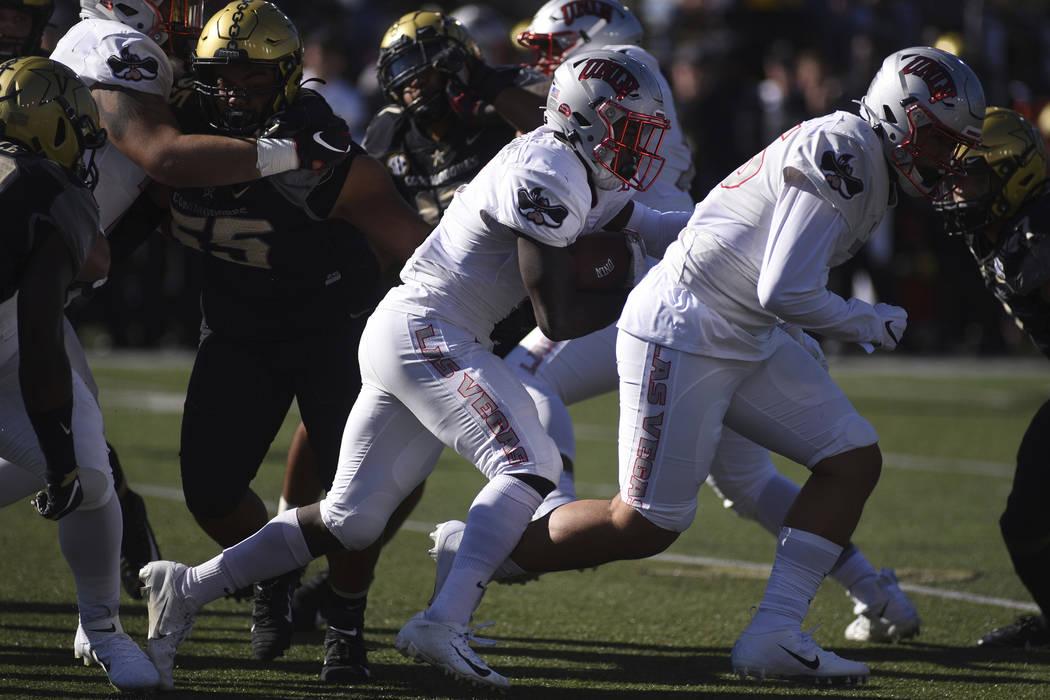 UNLV running back Charles Williams (8) runs against Vanderbilt in the first half of an NCAA col ...