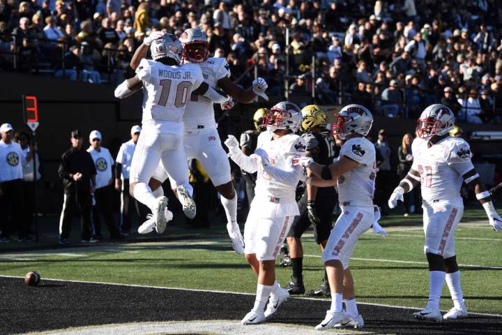 UNLV celebrates a touchdown against Vanderbilt in the first half of an NCAA college football ga ...