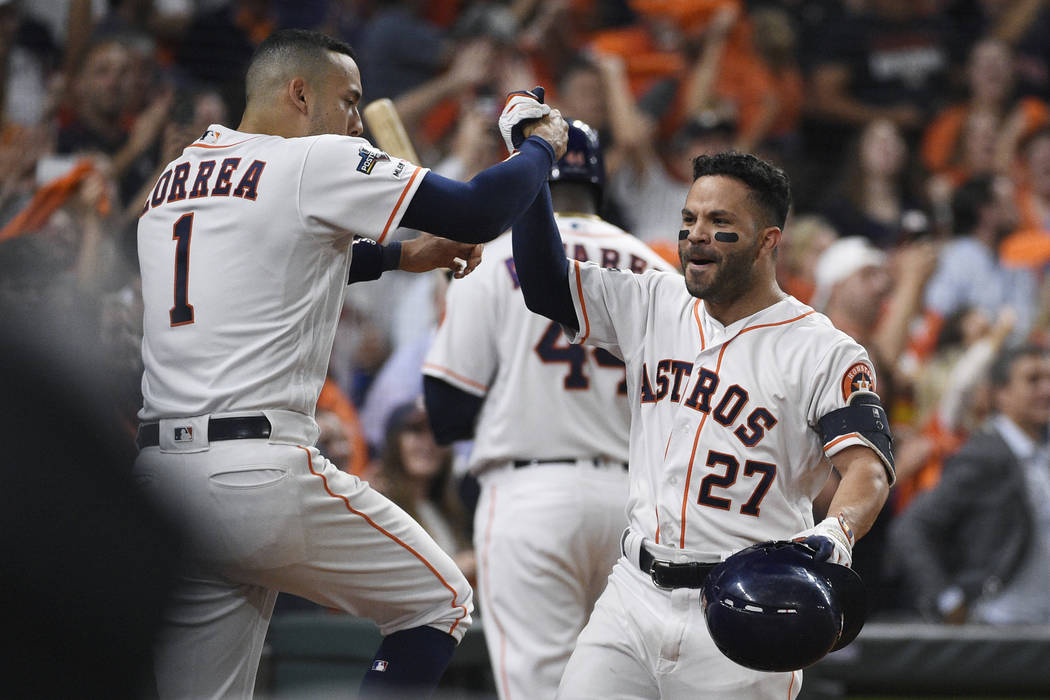 Houston Astros second baseman Jose Altuve (27) celebrates his solo home run against the Tampa B ...