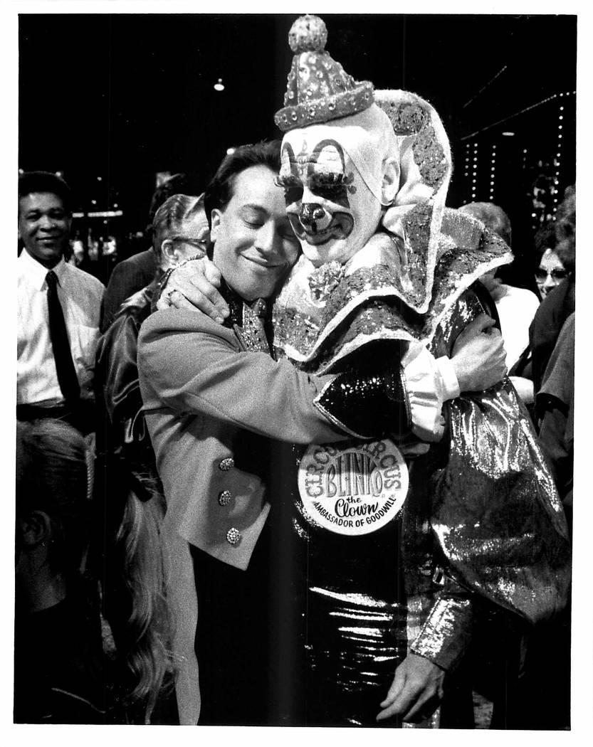 Blinko the Circus Circus Clown is retiring and gets hug from circus master on March 29, 1990 (L ...