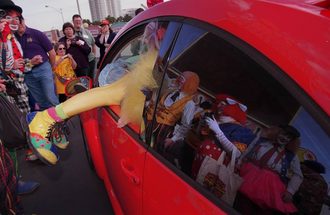 A Ringling Bros. and Barnum & Bailey Circus alumni clown climbs into a 2001 Volkswagen Beet ...