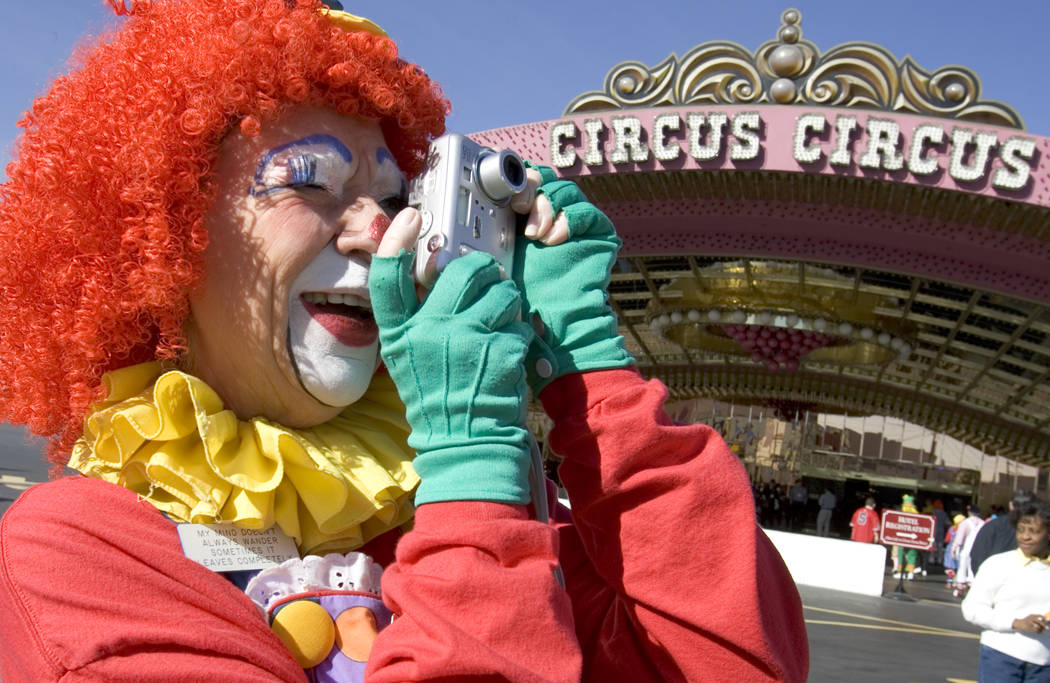 Miss Motzi, from Midland, Texas, takes a photo of other clowns in front of Circus-CIrcus on Thu ...