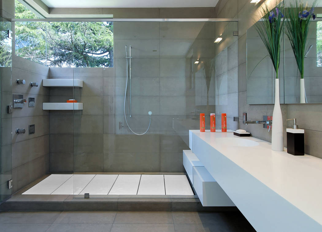 Maydan Architects has used Tatami ceramic removable tiles in bathroom showers. The product is g ...