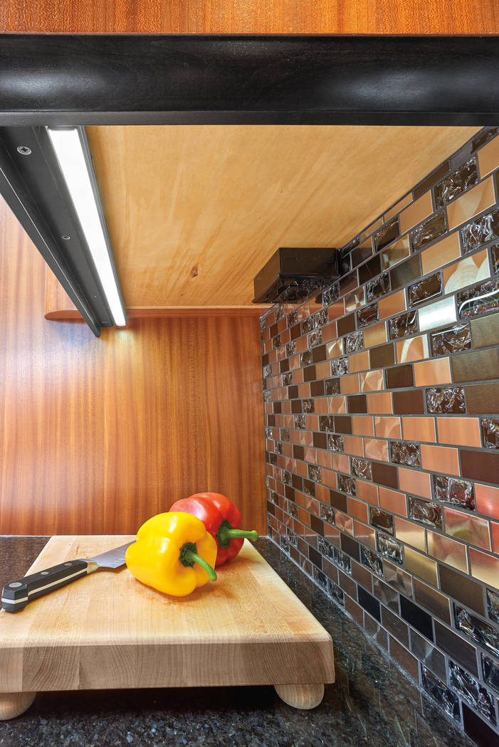Under-cabinet lighting can be turned to the side to highlight the backsplash or turned downward ...