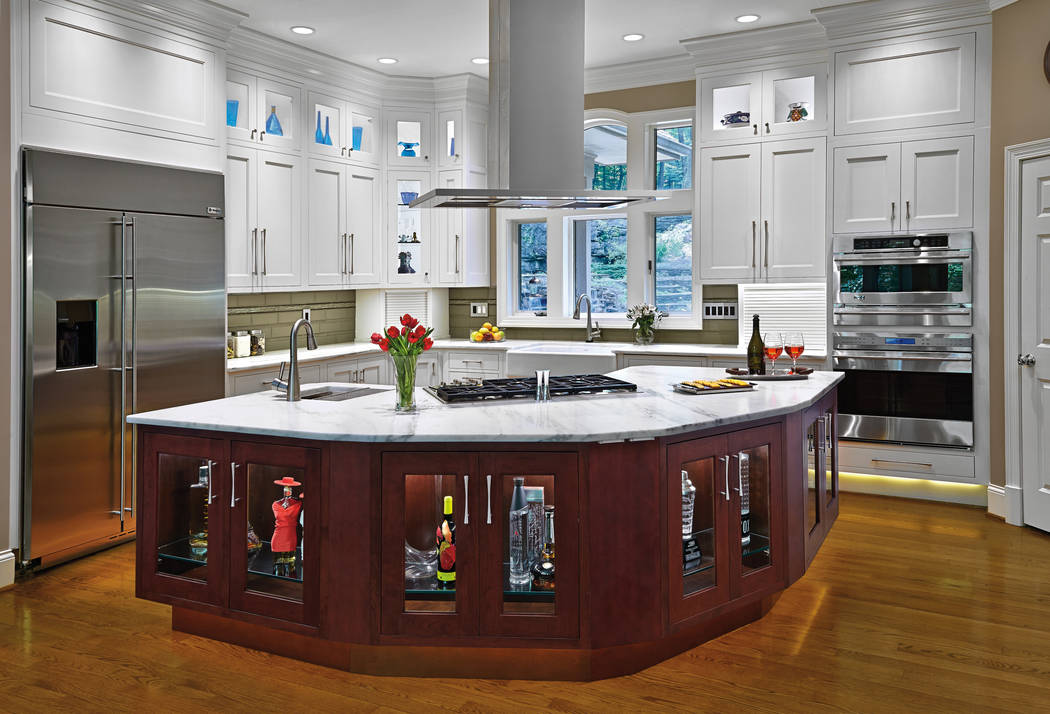 This kitchen has lighting that fits all needs, including accent, showcase, task and natural. (G ...