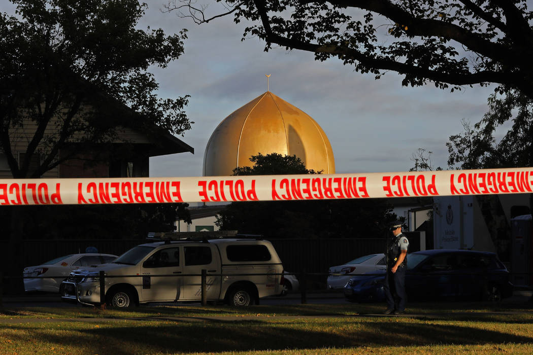 A police officer stands guard in front of the Masjid Al Noor mosque in Christchurch, New Zealan ...
