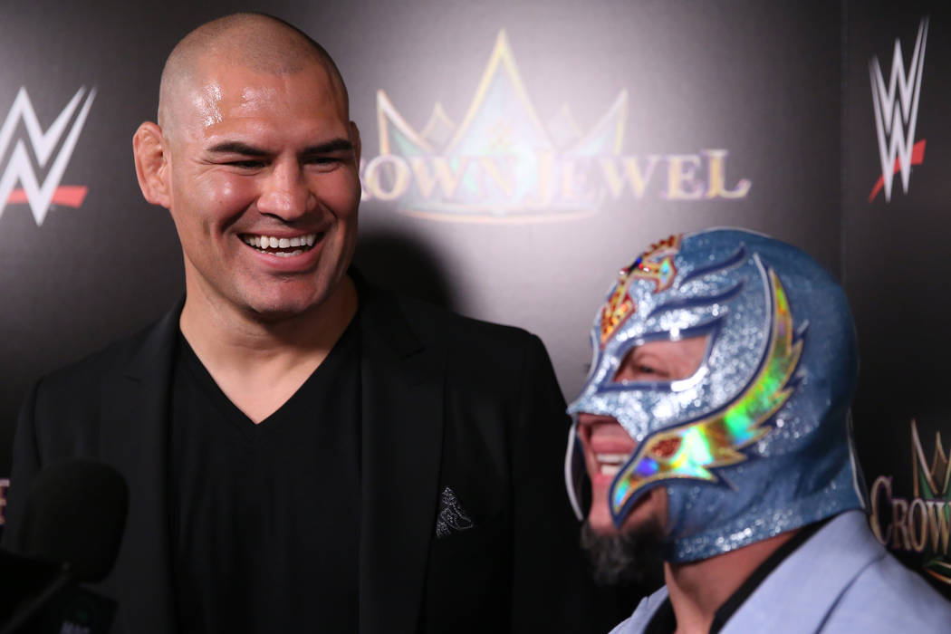 Cain Velasquez, left, and Rey Mysterio, are interviewed during a World Wrestling Entertainment ...