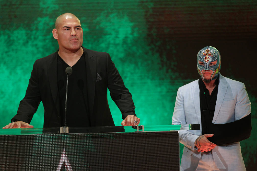 Cain Velasquez, left, and Rey Mysterio, during a World Wrestling Entertainment press conference ...
