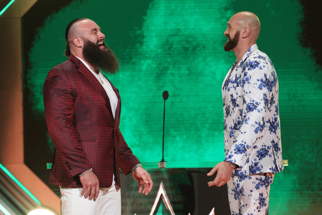 Braun Strowman, left, with Tyson Fury, pose during a World Wrestling Entertainment press confer ...