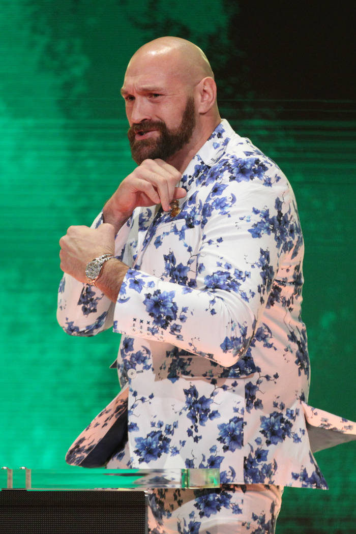 Tyson Fury poses during a World Wrestling Entertainment press conference at T-Mobile Arena in L ...